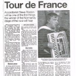 British accordionist greets cyclists on the winning line of the Tour de France